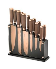 The Skandia Forte Kitchen Knives & Block Set by Hampton Forge consists of magnetic knife block and 12 kitchen knives with a glossy copper finish and non-stick stainless steel blades that are exceptionally fine and super sharp. Kitchen Knives, Kitchen Gadgets, Kitchen Cutlery, Copper Kitchen Utensils, Magnetic Knife Blocks, Copper Kitchen Accessories, Copper Kitchen Decor, Copper Decor, Rose Gold Kitchen Appliances