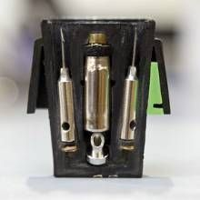 What's inside a TASER Cartridge?  Probes, nitrogen gas capsule, anti-felon identification (AFID) tags, puncture pin, etc. Tasing Arizona - Phoenix Magazine. http://www.phoenixmag.com/lifestyle/valley-news/201307/tasing-arizona-full-version/