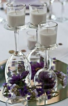 Upside down stemware used as candle holders and flowers inside the glass. Place them on a mirror tray for extra special effect.