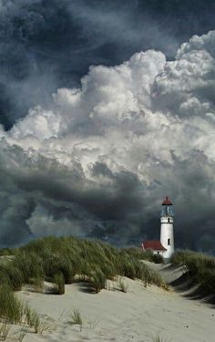 Lighthouse and storm clouds Storm Clouds, Sky And Clouds, Places Around The World, Around The Worlds, Beautiful World, Beautiful Places, Beautiful Beach, All Nature, Stock Foto
