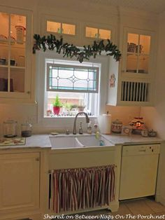 Farmhouse Kitchen Renovation With A Big Chill Refrigerator - Stained glass panel hangs above sink in a remodeled kitchen.