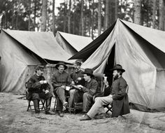 """October 1864. """"Petersburg, Virginia. Hospital stewards of 2d Division, 9th Corps, in front of tents."""" Wet plate glass negative by Timothy O'Sullivan."""