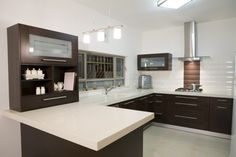 Kitchen, Elegant Modern White And Brown Kitchen Concept Along With A Single Rice Cooker And White Granite Countertos With Brown Chest Of Drawers With Wooden Cabinets Pendant Lamp And : Awesome Uniquely Kitchen Cabinet Styles