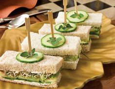 Cucumber-Avocado Tea Sandwiches A twist on the traditional cucumber tea sandwich, our version adds avocados, spinach, and alfalfa sprouts to the mix. Cucumber Tea Sandwiches, Tea Party Sandwiches, Finger Sandwiches, Funeral Sandwiches, Sandwich Recipes, Appetizer Recipes, Party Appetizers, Tea Recipes, Cooking Recipes