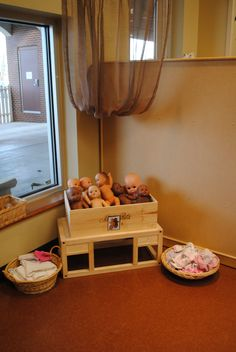 baby corner in dramatic play. Hmmmm colours suggest it may be Reggio inspired. I love that the babies multicultural too.