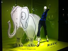 A whimsical window display at Marni, NYC. #retail #merchandising #display #illustration #elephant