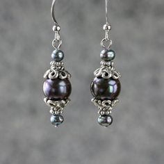 Hey, I found this really awesome Etsy listing at http://www.etsy.com/listing/92767879/black-pearl-drop-earrings-handmade-ani