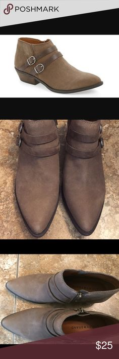 """Lucky Brand Jacquii bootie Jacquii bootie in brown leather. Shoe has two decorative straps. Pointy shoe can be worn with dresses, leggings and jeans.  Contrast buckle straps and a stacked wooden heel lend a casually rugged look to a pointy toe leather bootie in a versatile, abbreviated cut. 1 1/2"""" heel (size 8.5). 3 1/4"""" bootie shaft. Side zip closure. Leather upper/synthetic lining/rubber sole. Lucky Brand Shoes Ankle Boots & Booties"""