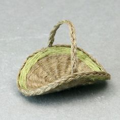 A braided edging finishes a 1:12 scale miniature flower gathering basket