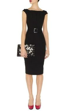 Classic black dress! Knee length, nice neckline.  Tight enough to show one is a woman, loose enough to show one is a lady!