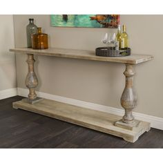 Give your living space a rustic look with this console table. It has an antiqued finish for a comfortable look that will complement many different types of styles and settings.