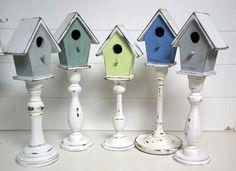 Vogelhuisje op kandelaar