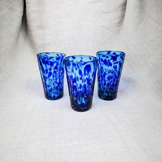 "A cobalt confetti speckles the aqua colored pint glasses consistently from first sip to last. Entertaining and festive these blue speckle glasses compliment summertime as well as iced tea. 3.5"" x 3.5"""