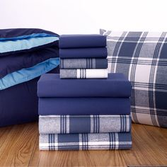 Light Blue/Navy extra-long twin comforter paired with Navy #plaid sheets. Reversible comforter for a versatile look.    Full Set (Bedding/Bath Towels) $159.00