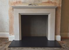 Custom limestone fireplace surround, slate hearth and rendered fireplace opening