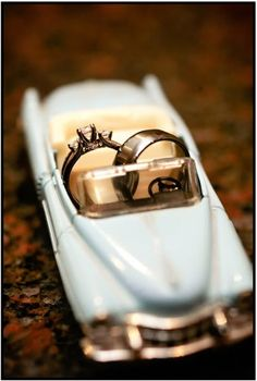 Picture of rings in a model car. Will have to have Tracy do a shot like this since we will have a few of his grandpa's collector cars around the reception in his memory. Such a sweet picture!
