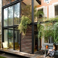 modern addition with new tall glass windows from second height to ground