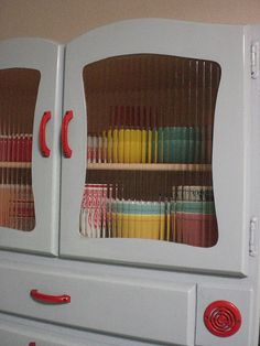 Visit my blog http://cdiannezweig.blogspot.com/ and my site http://iantiqueonline.ning.com/      I remember doing these!    great cupboard
