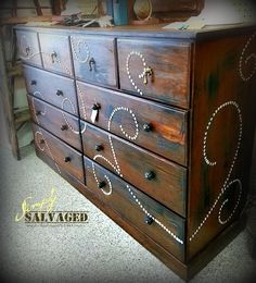 Use nailheads for a DIY swirl design | 99 Clever Ways To Transform A Boring Dresser