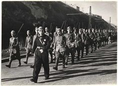 [Soldiers with guns marching out of Bilbao, Spain]