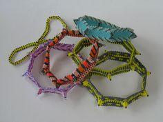 Tiny horn bangles( designer Kate McKinnon)