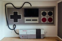 Nintendo game setup for TV and stand. Pretty cool :)