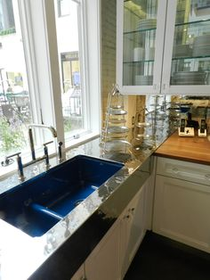 The Granite Gurus: House Beautiful's Kitchen of the Year 2012.    Jonathan Adler for Kohler Sink, color is Annapolis Navy.