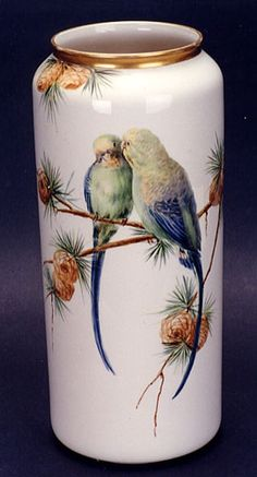 A WILLETS BELLEEK PORCELAIN FLORAL VASE, of cylindrical shape, hand painted with colorful love birds on pine branch.