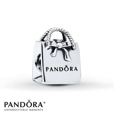 Just like the real thing, this sterling silver PANDORA Shopping Bag charm from the PANDORA Fall 2013 charm collection has the PANDORA inscription and realistic rope-textured handles. Style # 791184.