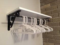 Solution for bedroom without a closet.  Brackets, board and cafe curtain rod from Lowe's created a place to hang clothes and a shelf.
