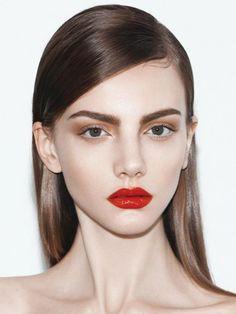 bright red lip, bold brows