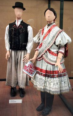 Couple from Martos, Komárom county, early century Hungarian Embroidery, Folk Clothing, Red Boots, Shawls And Wraps, Fashion History, Handmade Art, Traditional Outfits, Hungary, Lace Skirt