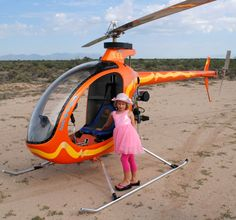 """Two of my favorite things . . . my precious granddaughter Hailey and my new Mosquito ultralight helicopter """"Apache""""."""