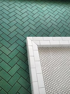 Brian Paquette. great combo of tiles styles here. The green herringbone looks great with the small hex.