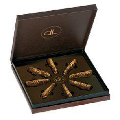 DeLafée's edible gold flakes shine like little stars on the Swiss chocolate pralinés.