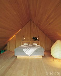 Bedroom/horizontal wood cladding and vertical panels make the ceiling look higher. Window at opposite end allow for light      guest cottage Swedish farmhouse