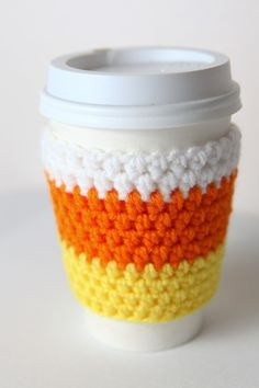 Crocheted Cuddly Candy Corn Coffee Cup Cozy. $15.00, via Etsy.