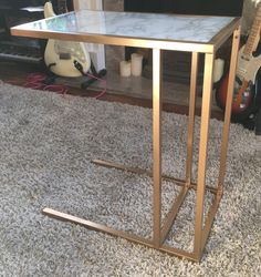 As daft as it sounds, I'd recently brought a new vase that would look perfect in one corner of my living room, but I needed to buy a table to stand the new vase on! I've got some gold and glass side tables in the room which I love, but they are all being used for other purposes (climbing frames and
