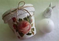 Flower pot in decoupage, lace and jute