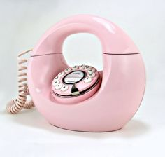 We tested it. Makes and receives calls perfectly. This oh-so-femme, pastel pink circle of a phone was made by Polyconcepts. It has push buttons