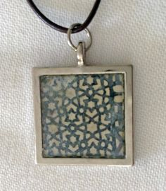 #handmade #leather accessories on Etsy This one of a kind handmade #necklace is made from #japanese #paper and #metallic pigment and then set in a bezel with resin. The #cord pictured is a tan calfskin necklace. You ... #trending #etsy #unique #purse #resin #pendant #silver #copper #print #chain