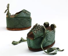 Chopines, about 1600, leather and satin damask over cork, Spain, c.1600. Museum no. T.419&A–1913. © Victoria and Albert Museum, London