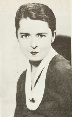 Well now, whoever would have thought that a boyish hair comb would turn a cute Colleen into such an ultra-sophisticate? Kay Francis had better look to her laurels! This is Colleen's own dark hair, smartly brushed back.
