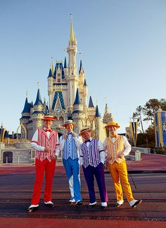 The Dapper Dans in front of the Cinderella Castle at the Magic Kingdom in Walt Disney World