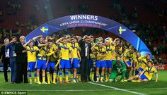 Sweden players celebrate winning the UEFA European Under 21 Championship trophy with a team salute