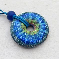 Flower batik pendant II made from polymer clay by Saffron Addict, via Flickr