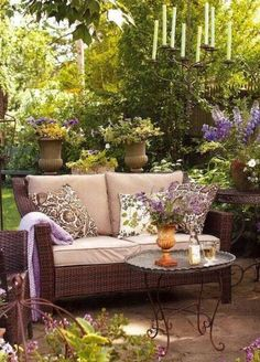 Mod Vintage Life: Outdoor Spaces/love the background of the patio and the candle chandelier