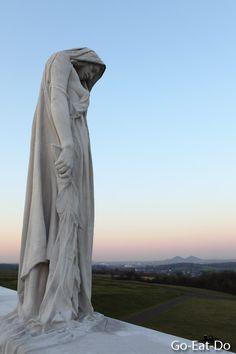 A sorrowful figure, representing Canada, at the Vimy Memorial.