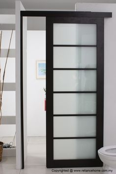 Nice Looking Frosted Sliding Single Bathroom Doors For Minimalist Bathroom Decors In White Painted Wall Interior Designs