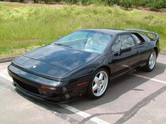 """98. Lotus Esprit (1993–2004)  Despite going through some awkward """"wedge"""" phases in its early days, the Esprit hit its stride with the early '90s S4 variant. By the twin-turbo V-8 generation, it had evolved into a legitimate exotic.      Read more: The 100 Hottest Cars of All Time - Popular Mechanics"""